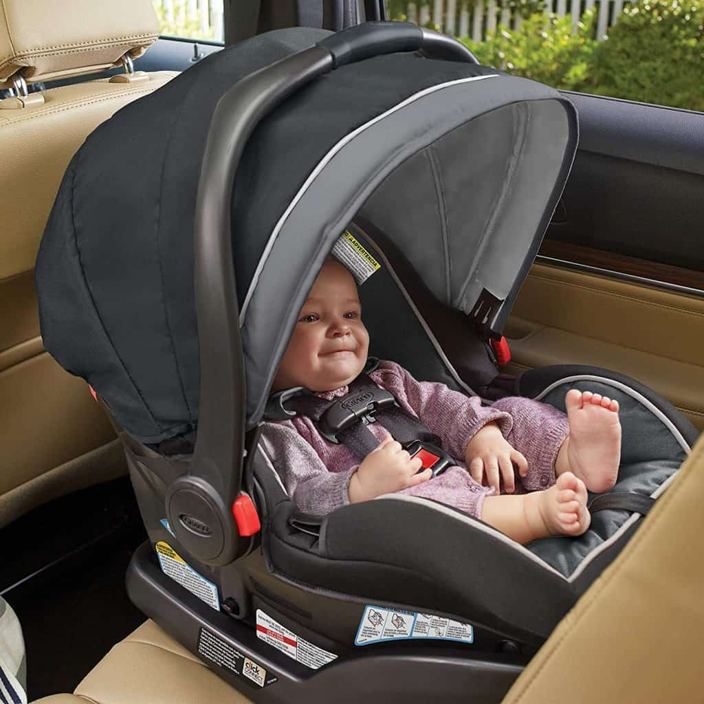 Graco SnugRide Infant Car Seat With Child Safely Belted In.